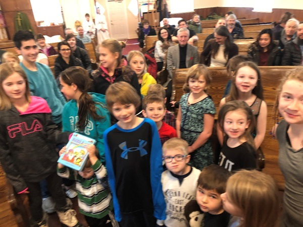 Gathering for Children's Liturgy of the Word at St. Theresa's Parish in Asquith.